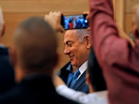 Israeli Prime Minister Benjamin Netanyahu smiles as he delivers a statement following a meeting of the Likud Party in Jerusalem on September 23, 2019.