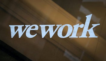 The WeWork logo is displayed on the entrance of a co-working space in New York City, New York U.S., January 8, 2019.