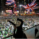 Anti-government protesters carry British flags as residents protest the shooting of a demonstrator, Hong Kong, October 2, 2019.