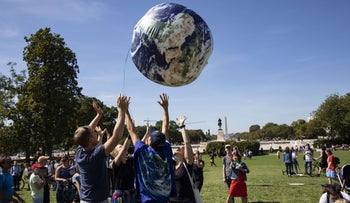 People toss an inflatable globe in the air in front of the U.S. Capitol Building during the Global Climate Strike protests on September 20, 2019 in Washington, D.C.