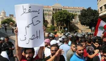 Demonstrators protest against corruption and deteriorating economic conditions, in front of the government palace in Beirut, Lebanon September 29, 2019.