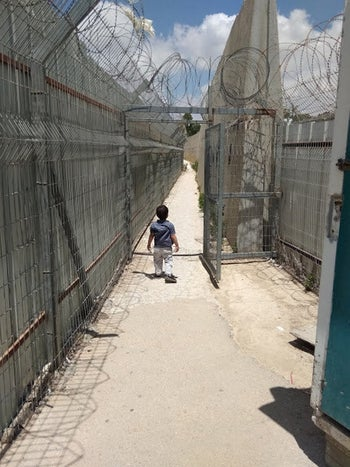 Khater's three-year-old Yihya at the entrance of Ofer Military Court before her remand was extended.