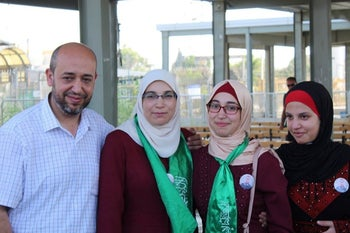 Lama Khater, second from left, her husband Hazem al-Fakhouri and their daughters upon her release from prison on July 26, 2019.