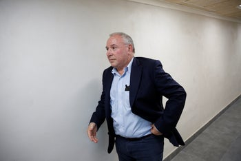 Communications Minister David Amsalem enters a government meeting, Jerusalem, August, 2019.