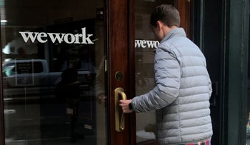 A man walks into a WeWork space in the Manhattan borough of New York City, New York, U.S., October 4, 2019.