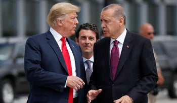 Donald Trump talks with Recep Tayyip Erdogan at a summit of heads of state and government at NATO headquarters in Brussels, July 11, 2018.