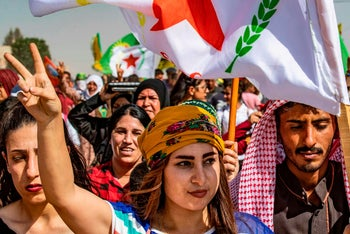 Syrian Kurds demonstrate against Turkish threats in the town of Ras al-Ain in Syria's Hasakeh province near the Turkish border, October 6, 2019.