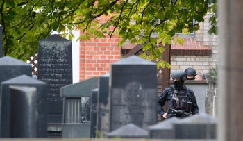 Policemen patrol a Jewish cemetery close to the site of a shooting in Halle, Germany, October 9, 2019