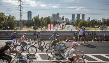 Cyclists on the streets of Tel Aviv on Yom Kippur, Wednesday, October 9, 2019.