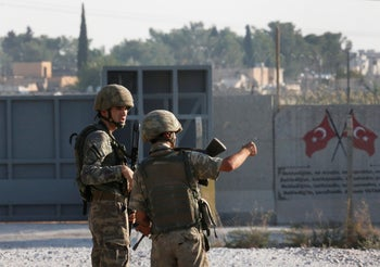Shortly after the Turkish operation inside Syria had started, Turkish soldiers stand at the border with Syria in Akcakale, Sanliurfa province, southeastern Turkey, Wednesday, Oct. 9, 2019.