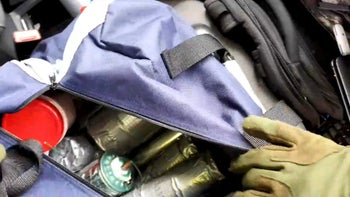 Apparent explosives cache is seen in a bag inside the vehicle used by a gunman in an attack on a synagogue in Halle, Germany October 9, 2019. Still image taken from the gunman's helmet camera video stream