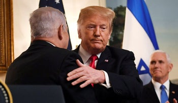 U.S. President Donald Trump embraces Israeli Prime Minister Benjamin Netanyahu, as Vice President Mike Pence looks on, in the Diplomatic Reception Room of the White House in Washington, March 25, 2019.
