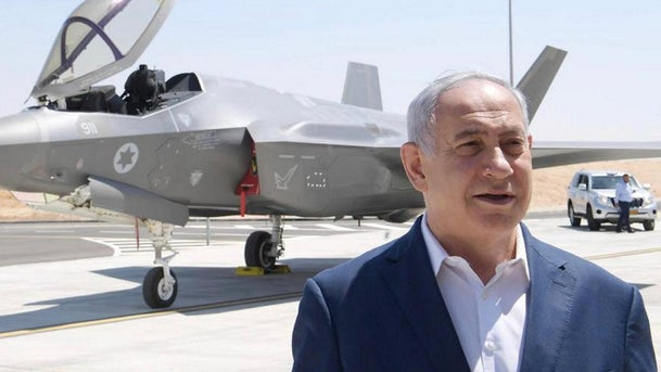 Netanyahu stands in front of an F-35 plane during a discussion on regional threats, July 9, 2019.