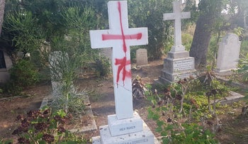 Defaced gravestone in the British cemetery, Haifa, Israel, October 11, 2019
