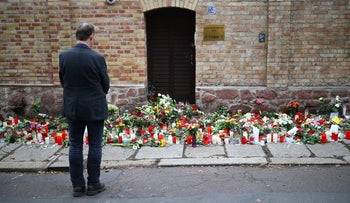 A man mourns in front of the synagogue in Halle, Germany, October 11, 2019.