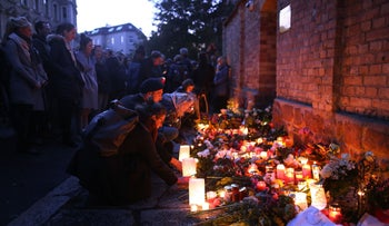 Mourners light candles at the synagogue in Halle, eastern Germany, October 10, 2019.