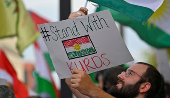 A protester among a crowd of over 500 people demonstrating in support of Kurds after the Trump administration changed its policy in Syria, in front of the federal courthouse in Nashville, Tennessee, October 11, 2019.