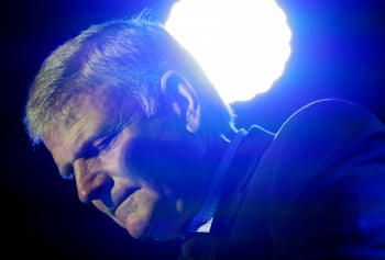 The Rev. Franklin Graham leading the audience in prayer as he speaks at his Decision America event at the Pitt County Fairgrounds in North Carolina on October 2, 2019.