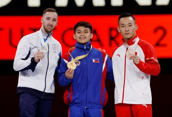 Silver medalist Israel's Artem Dolgopyat, gold medalist Philippines' Carlos Edriel Yulo and bronze medalist China's Xiao Ruoteng pose for a photo during the medals ceremony on October 12, 2019.
