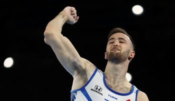 Artem Dolgopyat of Israel clenches his fist after his performance on the floor in the men's apparatus finals at the Gymnastics World Championships in Stuttgart, Germany, October 12, 2019.