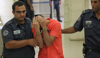 One of the defendants in Abu Khdeir's killing appears before the Jerusalem District Court, August 6, 2014.