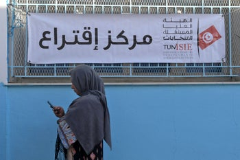 A Tunisian voter waits outside a polling station in the capital Tunis, October 13, 2019.