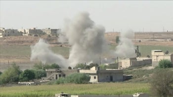 Smoke rises from an explosion during an offensive by Turkish-led forces in Tel Abyad, Syria, October 13, 2019.