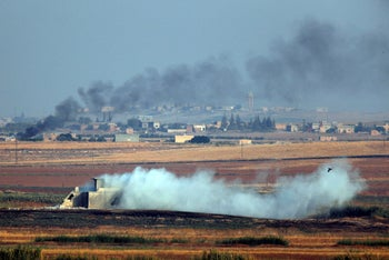 Smoke billows from targets inside Syria during bombardment by Turkish forces Wednesday, October 9, 2019.