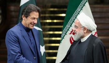 Iranian President Hassan Rohani with Pakistan's Prime Minister Imran Khan after their joint press conference in the Iranian capital Tehran, October 13, 2019.