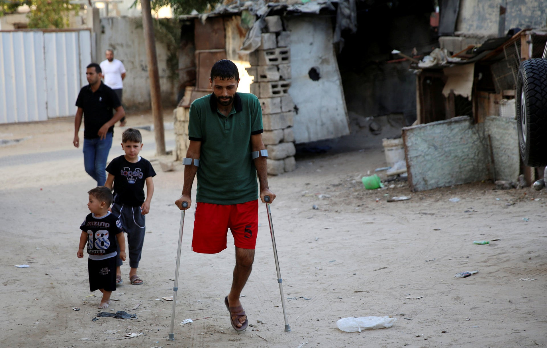 Palestinian amputee Ziad al-Madani, who lost his leg when he was shot by Israeli troops during a protest on the border, walks on the main street of Khan Younis, Gaza Strip, October 2, 2019.