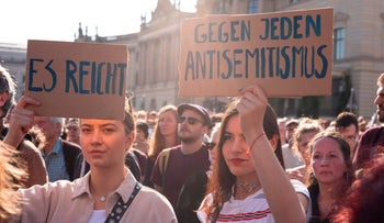 """Protesters holding placards reading """"That's enough"""", """"Against any aniti-Semitism"""" rally against anti-Semitism at Bebelplatz square in the centre of Berlin,on October 13, 2019."""