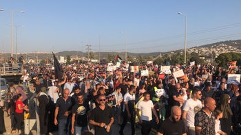 Demonstrators march in Wadi Ara protesting violence in the Arab Israeli community, on Sunday, October 13, 2019.