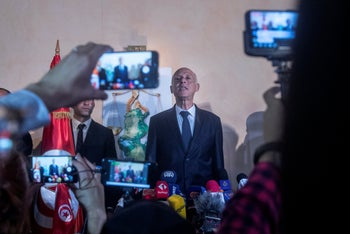 Kais Saied speaks to the reporters and supporters in Tunis, October 13, 2019.