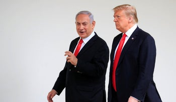 U.S. President Donald Trump and visiting Israeli Prime Minister Benjamin Netanyahu walk along the Colonnade of the White House in Washington,on March 25, 2019.