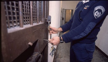 An officer locks a cell at Kishon prison, where al-Labadi is being held.