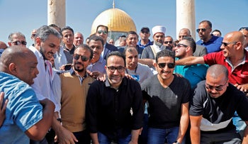 Saudi national soccer team players and coaches pose for a group picture at the al-Aqsa Mosque compound, Jerusalem, October 14, 2019.