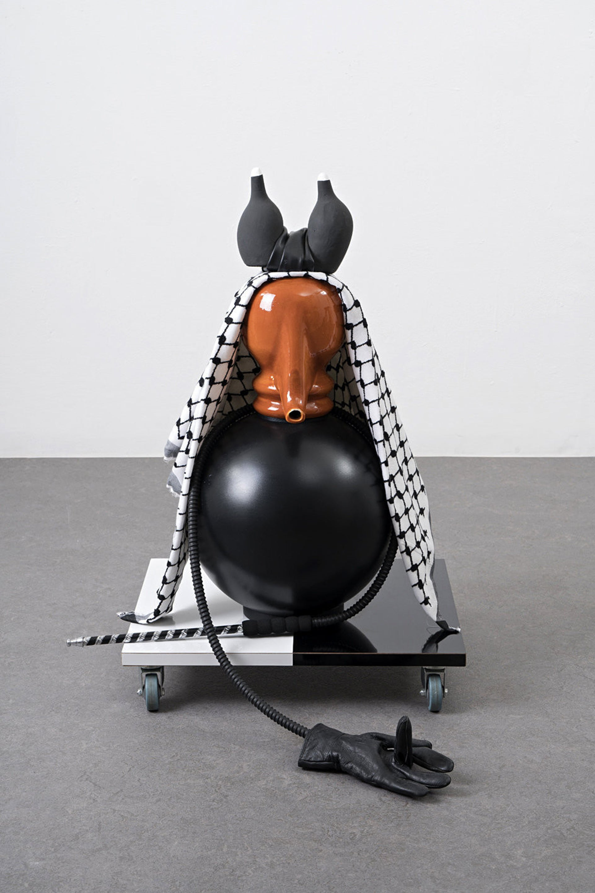 Another piece in the exhibition is a jug topped by a kaffiyeh. The jug was once in the home of Nadia Cohen, the widow of Eli Cohen, the Israeli spy executed in Syria in 1965.