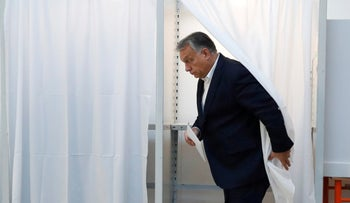 Hungarian Prime Minister Viktor Orbán walking out of a voting booth during Hungary's local elections in Budapest, Hungary, October 13, 2019.