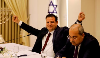 The Joint List's Ayman Odeh reacts next to Ahmad Tibi during a consulting meeting with Israeli President Reuven Rivlin, in Jerusalem, on September 22, 2019.