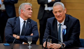 Kahol Lavan leaders Benny Gantz and Yair Lapid sit together during a party meeting at the Knesset in Jerusalem, October 3, 2019.