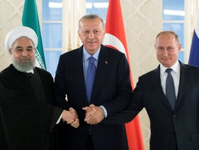 Rohani, Erdogan and Putin shake hands.