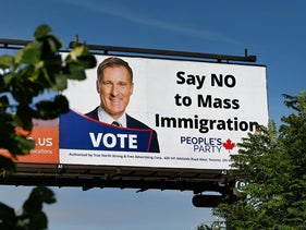"A billboard featuring the portrait of People's Party of Canada (PPC) leader Maxime Bernier and its message ""Say No to Mass Immigration"" in Toronto, August 26, 2019."