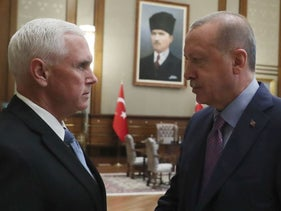 U. S. Vice President Mike Pence, left, and Turkish President Recep Tayyip Erdogan shake hands before their talks at the presidential palace, in Ankara, Turkey, Thursday, Oct. 17, 2019