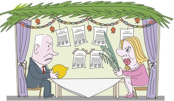 Benjamin and Sara Netanyahu sit in a sukkah decorated with loyalty declarations.