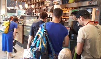 People queue at the Aroma branch at Weizmann Street in Tel Aviv.
