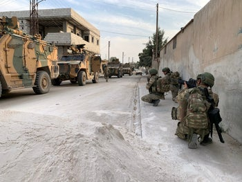 Turkish soldiers are seen in the border town of Tal Abyad, Syria, in this undated photo released by Turkish Defense Ministry on October 17, 2019.