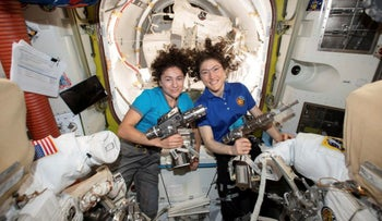 Jessica Meir, left, and Christina Koch pose for a photo in the International Space Station, October 18, 2019.