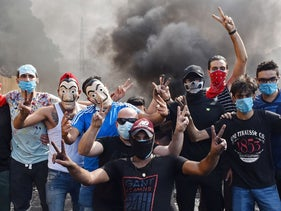 Lebanese protesters block a main road near Beirut amidst ongoing protests, on October 18, 2019.