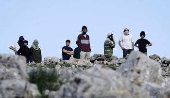 Settlers from Yitzhar during clashes with Palestinians near Nablus, January 14, 2014.
