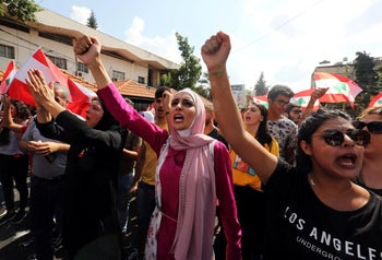 Demonstrators chant and carry national flags during an anti-government protest in the southern city of Nabatiyeh, Lebanon October 20, 2019.